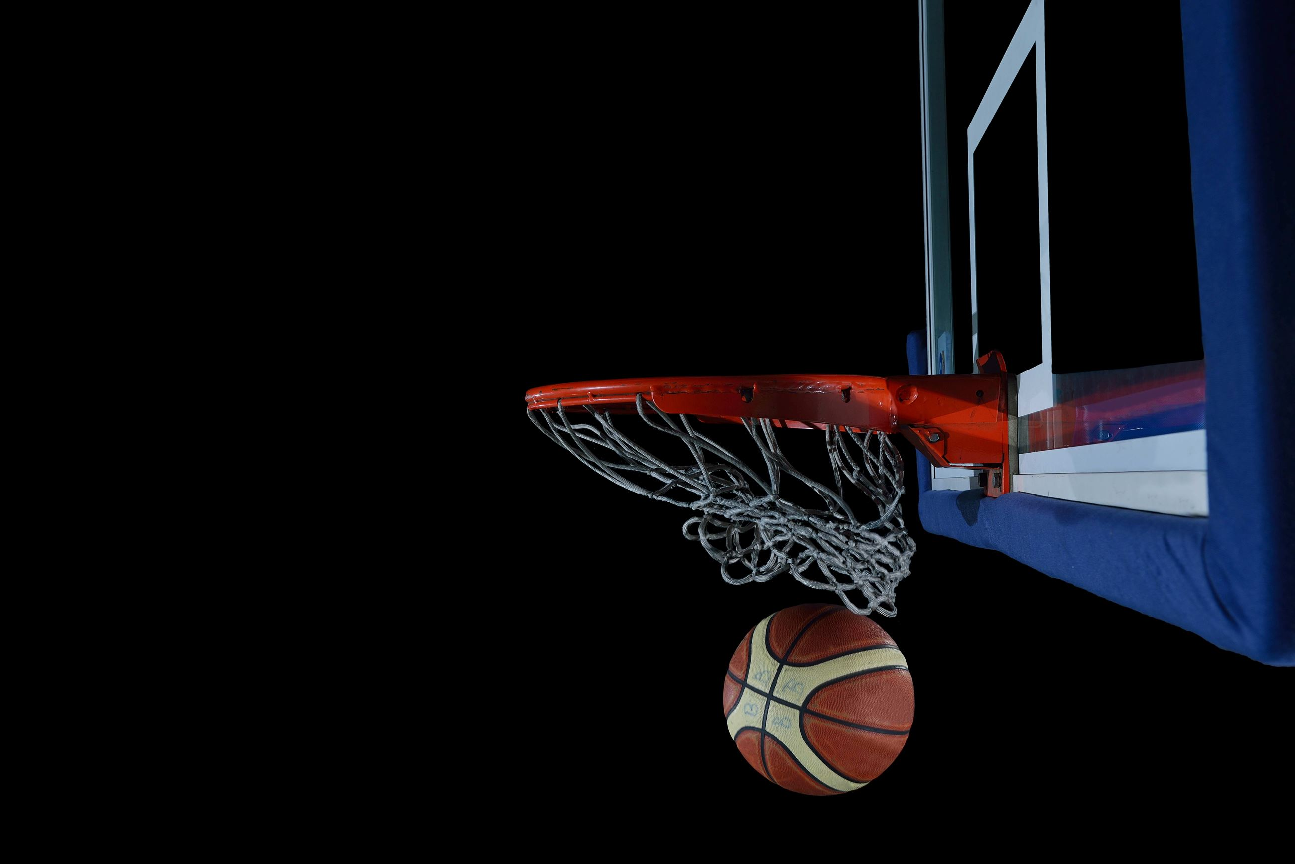 backboard-and-net-on-black-background-in-gym-indoor